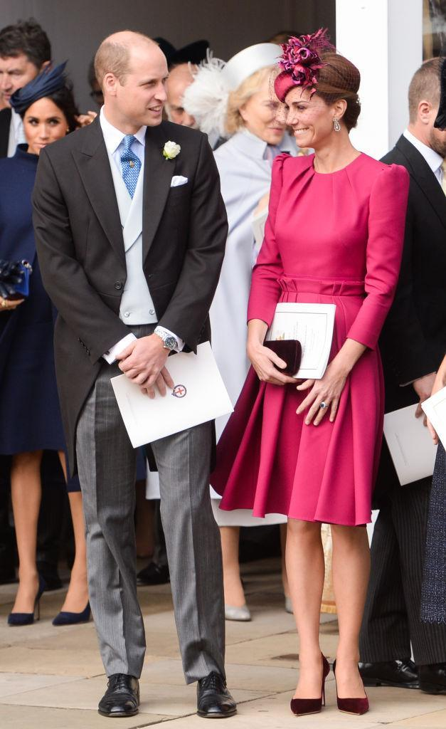 <p>The Duchess of Cambridge surprised royal fans by eschewing her go-to tradition of wearing pastel hues in favour of a bold raspberry dress for Princess Eugenie's big day on October 12. The ensemble was courtesy of Alexander McQueen and was finished with a Philip Treacy hat. <em>[Photo: Getty]</em> </p>