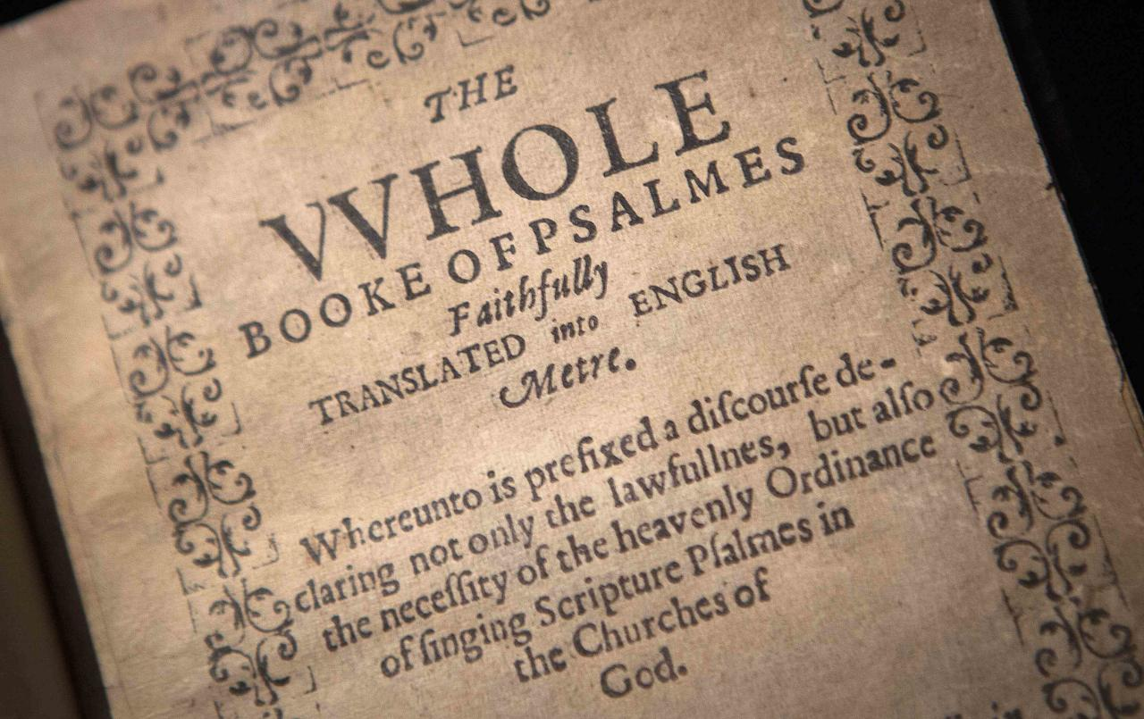 """A copy of """"The Bay Psalm Book"""" is pictured at Sotheby's Auction House in New York, November 21, 2013. Published in 1640, the Bay Psalm Book is considered the first book printed in what was then the British colonies of North America. With only eleven copies left in existence, Sotheby's expects the book to sell for up to $30 million U.S. dollars at auction on November 26. REUTERS/Carlo Allegri (UNITED STATES - Tags: MEDIA SOCIETY RELIGION)"""