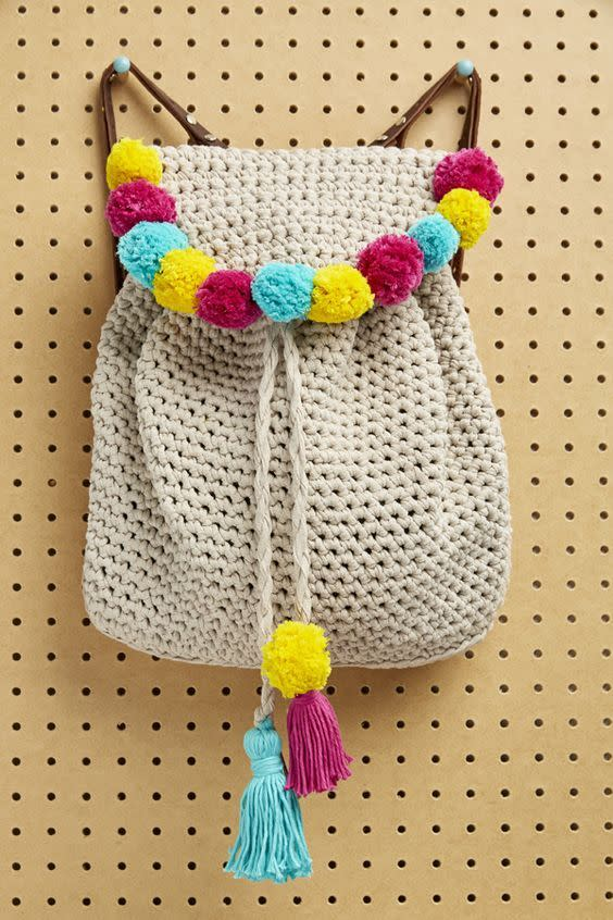 "<p>Get festival ready by adding a few rainbow pom poms onto your backpack.  <i><a href=""https://uk.pinterest.com/pin/413416440772215324/"">[Photo: Pinterest]</a></i></p>"