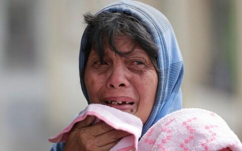 Local residents have been traumatised by the volcano's eruption - Credit: Aaron Favila/AP