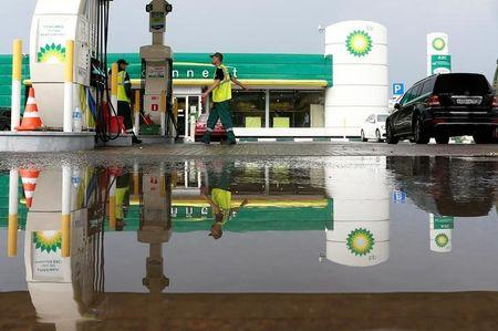 A BP petrol station is reflected in a puddle in Moscow, Russia, July 4, 2016. REUTERS/Sergei Karpukhin
