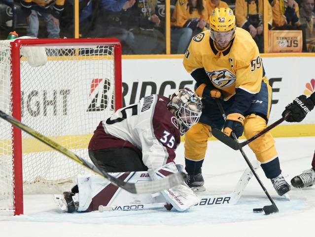Nashville Predators defenseman Roman Josi (59) tries to get the puck past Colorado Avalanche goaltender Andrew Hammond (35) on a power play during the second period in Game 5 of an NHL hockey first-round playoff series Friday, April 20, 2018, in Nashville, Tenn. (AP Photo/Sanford Myers)