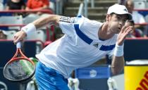 Andy Murray, from Great Britain, runs for the ball against Marcel Granollers, from Spain, during the Rogers Cup men's tennis tournament in Montreal on Wednesday, Aug. 7, 2013. (AP Photo/The Canadian Press, Paul Chiasson)