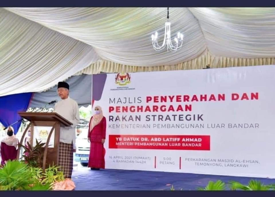 Tun Dr Mahathir Mohamad speaks during an event with the backdrop bearing the name of minister Datuk Abdul Latiff Ahmad from his old party, Parti Pribumi Bersatu Malaysia. — Picture via Facebook/Pemuda Umno Malaysia