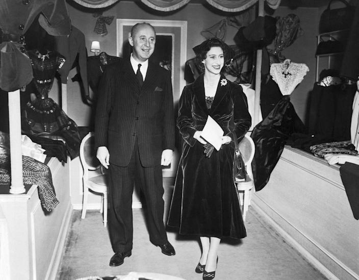 """<p>Princess Margaret made no secret of her love for Christian Dior's designs and the royal often attended his presentations in Paris. However, at the time, <a href=""""https://www.bbc.com/culture/article/20180424-the-meghan-effect-is-nothing-new"""" rel=""""nofollow noopener"""" target=""""_blank"""" data-ylk=""""slk:royals were expected to support British designers"""" class=""""link rapid-noclick-resp"""">royals were expected to support British designers</a> by wearing them exclusively—the princess, however, did not care.</p>"""