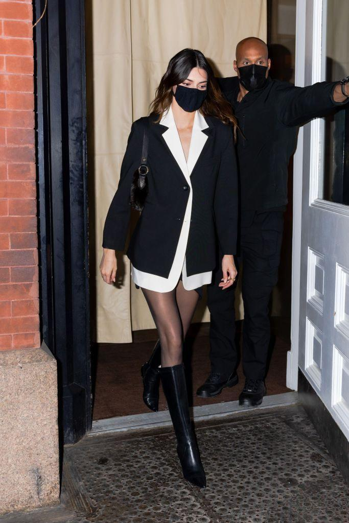 """<p>Supermodel Kendall Jenner stepped out for dinner in New York in the best date night outfit ever. Giving us serious <a href=""""https://www.youtube.com/watch?v=ZJL4UGSbeFg&ab_channel=ShaniaTwainVEVO"""" rel=""""nofollow noopener"""" target=""""_blank"""" data-ylk=""""slk:Shania Twain 'Man! I Feel Like A Woman'"""" class=""""link rapid-noclick-resp"""">Shania Twain 'Man! I Feel Like A Woman'</a> vibes, the 25-year-old paired an oversized shirt and blazer with <a href=""""https://www.elle.com/uk/fashion/what-to-wear/g18985/autumn-winter-tights/"""" rel=""""nofollow noopener"""" target=""""_blank"""" data-ylk=""""slk:sheer tights"""" class=""""link rapid-noclick-resp"""">sheer tights</a> and <a href=""""https://www.elle.com/uk/fashion/what-to-wear/articles/g17663/knee-high-boots/"""" rel=""""nofollow noopener"""" target=""""_blank"""" data-ylk=""""slk:knee-high boots"""" class=""""link rapid-noclick-resp"""">knee-high boots</a>.</p><p><a class=""""link rapid-noclick-resp"""" href=""""https://go.redirectingat.com?id=127X1599956&url=https%3A%2F%2Fwww.net-a-porter.com%2Fen-gb%2Fshop%2Fproduct%2Fjimmy-choo%2Fmahesa-85-leather-knee-boots%2F1272160&sref=https%3A%2F%2Fwww.elle.com%2Fuk%2Ffashion%2Fcelebrity-style%2Farticles%2Fg2543%2Fkendall-jenner%2F"""" rel=""""nofollow noopener"""" target=""""_blank"""" data-ylk=""""slk:SHOP KNEE-HIGH BOOTS NOW"""">SHOP KNEE-HIGH BOOTS NOW</a></p>"""