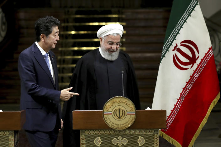 Japanese Prime Minister Shinzo Abe, left, and Iranian President Hassan Rouhani, attend a joint press conference after their meeting at the Saadabad Palace in Tehran, Iran, Wednesday, June 12, 2019. The Japanese leader is in Tehran on an mission to calm tensions between the U.S. and Iran. (AP Photo/Ebrahim Noroozi)