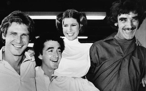 Harrison Ford, Anthony Daniels, Carrie Fisher, and Peter Mayhew during a break from the filming - Credit: AP
