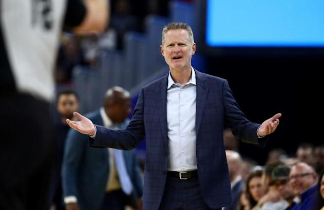 Golden State Warriors coach Steve Kerr was fined $25,000 by the NBA on Wednesday for verbal abuse of a referee during his team's loss Monday at Sacramento (AFP Photo/EZRA SHAW)