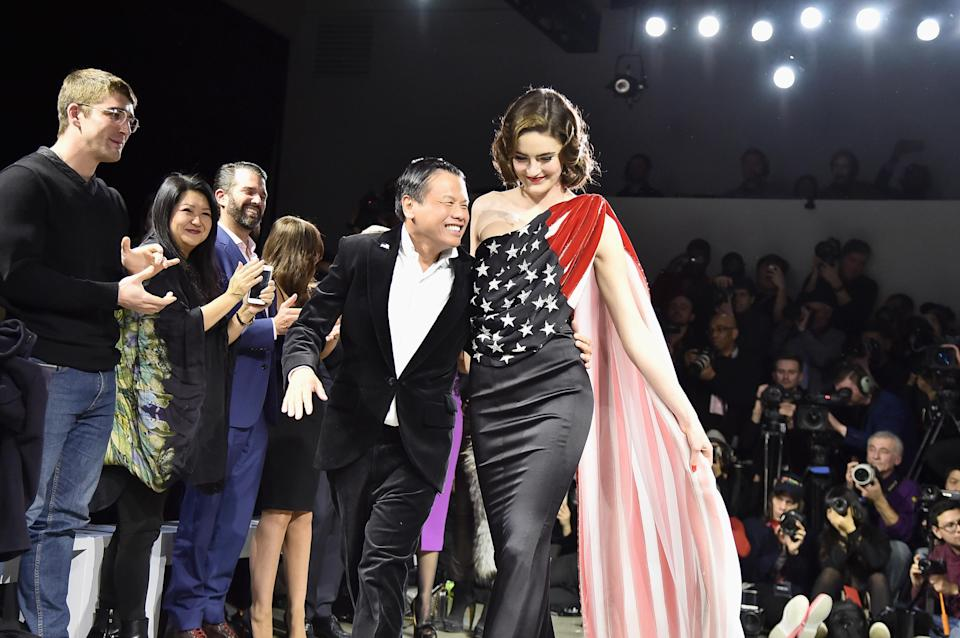 Zang Toi with a model in one of his America-inspired designs. (Photo: Theo Wargo/Getty Images for NYFW: The Shows)