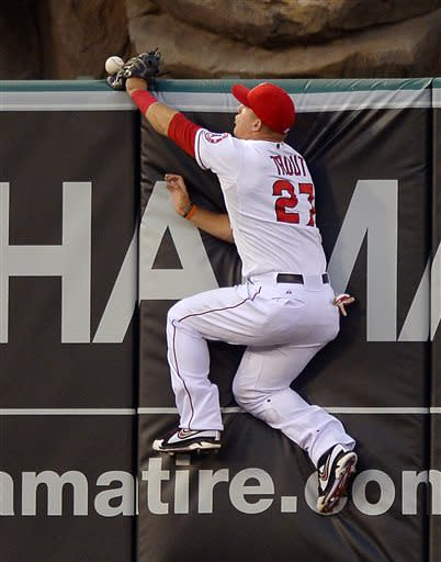 Los Angeles Angels center fielder Mike Trout can't get to a ball hit for a two-run home run by St. Louis Cardinals' Jon Jay during the second inning of a baseball game, Wednesday, July 3, 2013, in Anaheim, Calif. (AP Photo/Mark J. Terrill)