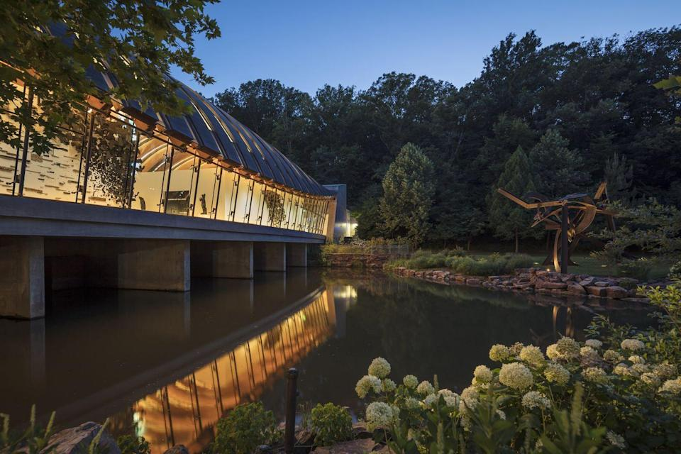"<p><a href=""https://crystalbridges.org/"" rel=""nofollow noopener"" target=""_blank"" data-ylk=""slk:Crystal Bridges Museum of American Art"" class=""link rapid-noclick-resp"">Crystal Bridges Museum of American Art </a></p><p>This outstanding space in Bentonville not only houses some pretty amazing art, but is known for its unique buildings and walking trails. They use the space to craft some special exhibitions like the North Forest Lights, which is an immersive experience bringing amazing lights to the forest There's a large American art collection, architecture, including a house created by Frank Lloyd Wright. The entire space is free to visit, as it is sponsored by Walmart (which has its roots in this town, and there is even a <a href=""https://www.walmartmuseum.com/content/walmartmuseum/en_us.html"" rel=""nofollow noopener"" target=""_blank"" data-ylk=""slk:museum dedicated to the chain store nearby"" class=""link rapid-noclick-resp"">museum dedicated to the chain store nearby</a>). </p>"
