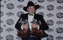 <p>Following a successful night of wins, Brooks hits the 26th Annual Academy of Country Music Awards red carpet in 1991 to pose with his awards.</p>