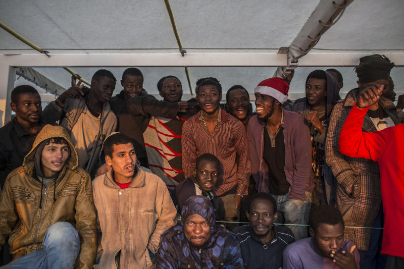 Migrants gather on the deck of the Spanish NGO Proactiva Open Arms rescue vessel after being rescued in the central Mediterranean sea Dec. 21, 2018, before disembarking in the port of Crinavis in Algeciras, Spain, Friday, Dec. 28, 2018. Other European countries such as Italy, Malta or Greece closed their ports to the ship and only Spain admitted its entry. To reach Crinavis they have sailed for 6 days with more than 300 migrants on board. (AP Photo/Olmo Calvo)