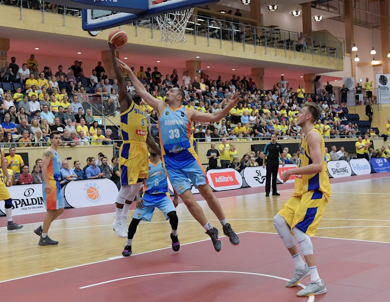 Basketball - Sweden v Armenia - FIBA Basketball World Cup 2019 European Pre-Qualifiers Group A - IFU Arena in Uppsala - August 16, 2017. Sweden's Thomas Massamba is bloccked by Armenia's Ararat Kochinyan. TT News Agency/via REUTERS ATTENTION EDITORS - THIS IMAGE WAS PROVIDED BY A THIRD PARTY. SWEDEN OUT.