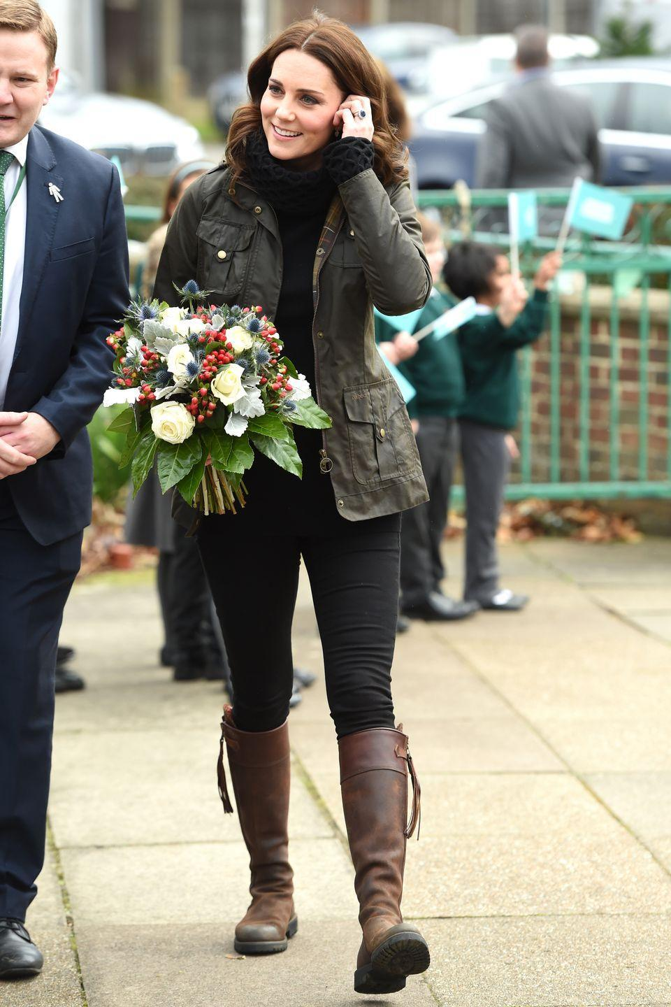 <p>The Duchess wears an army green cargo jacket, Temperley London turtleneck sweater, skinny jeans, and Penelope Chilvers brown leather tassel boots during a visit to Robin Hood Primary School.</p>
