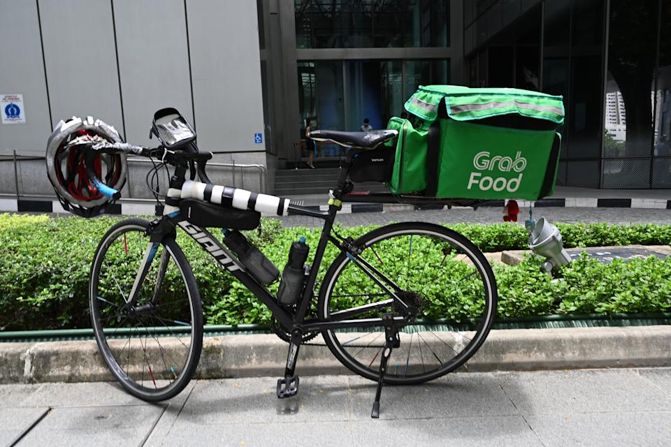 A Grab food delivery bicycle is parked along pavement at Raffles Place in Singapore on September 15, 2020. (Photo by Roslan RAHMAN / AFP) (Photo by ROSLAN RAHMAN/AFP via Getty Images)
