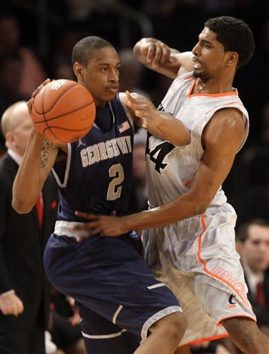 Cincinnati's Jaquon Parker, right, defends Georgetown's Greg Whittington during the quarterfinal round of the Big East NCAA college basketball conference tournament in New York, Thursday, March 8, 2012. (AP Photo/Seth Wenig)