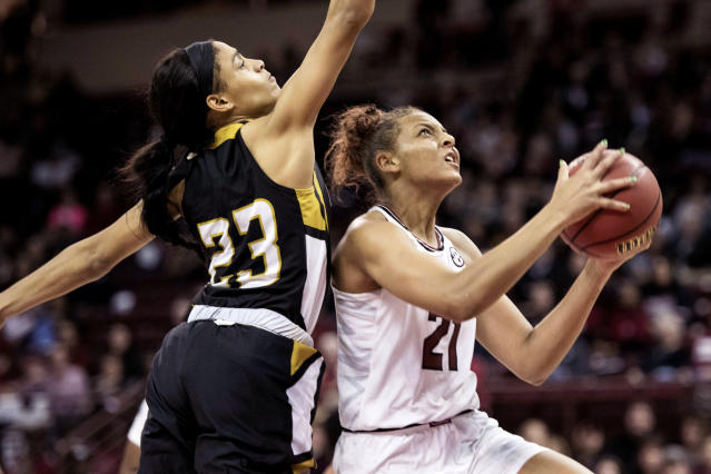 FILE - In this Nov. 10, 2017, file photo, South Carolina forward Mikiah Herbert Harrigan (21) attempts to shoot against Alabama State guard Arleatha Gipson (23) during the second half of an NCAA college basketball game in Columbia, S.C. South Carolina players Herbert Harrigan and Tyasha Harris went sixth and seventh to Minnesota and Dallas in the first round of the WNBA Draft, Friday, April 17, 2020. (AP Photo/Sean Rayford, File)