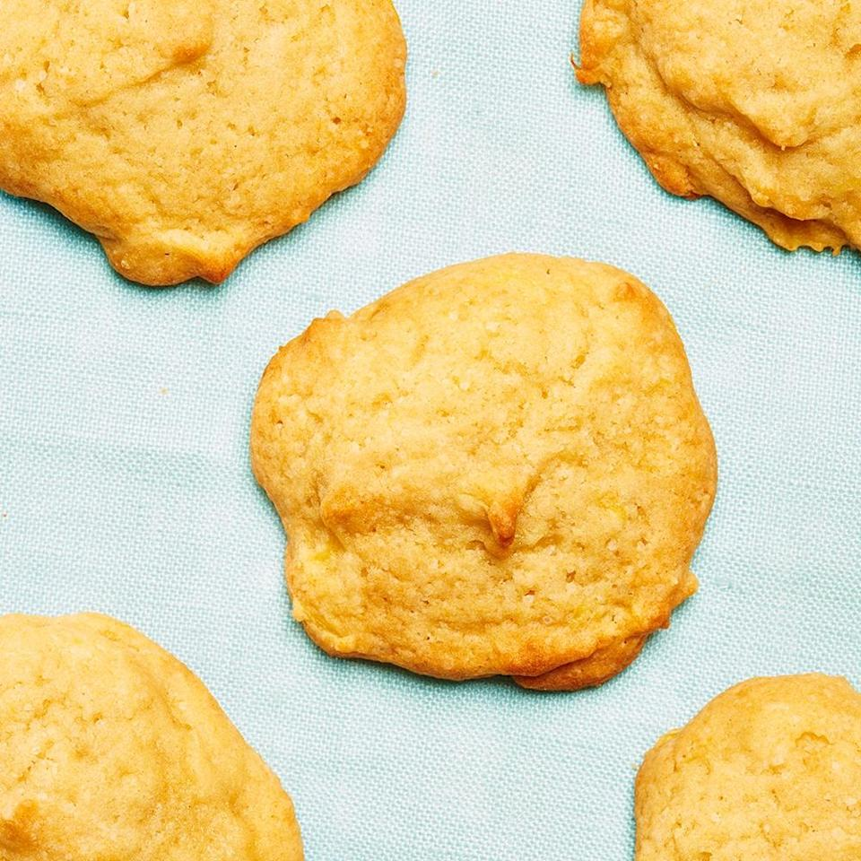"""<strong>Pineapple Cookies</strong><br>Yield: Approximately 5 dozen cookies<br><br><strong>Megan McIntyre</strong><em>: """"When my mom first made these, I was, to put it nicely, skeptical. I recall making exaggerated gagging noises as she dumped the canned pineapples into the batter. But, cookie junkie that I am, I grabbed one and after one bite of the cookie I was a goner. These cookies are juicy and soft, with just a hint of tart to cut through the sweetness. It's kind of like a piña colada cookie, but way less gross. Now, every time I go home, I beg my mom to make me a batch so that I can snarf it down furtively at night, crouched over the tin like a feral animal. Mmmmmm, cookies.""""</em><br><br><strong>Ingredients</strong><br>2 eggs, well beaten<br>1 cup brown sugar<br>1 cup white sugar<br>1 cup shortening<br>1 whole can of crushed pineapple<br>1 tsp vanilla<br>1/2 tsp salt<br>1 tsp baking soda<br>4 cups flour<br><br><strong>Instructions</strong><br>1. Preheat your oven to 350ºF.<br><br>2. Beat the eggs, and then add in the white and brown sugar, shortening, and pineapple. Mix well then add vanilla.<br><br>3. Mix dry ingredients together in a separate bowl, and then slowly add to wet mixture. Your mixture should be a consistency that is easily dropped by spoonfuls, not overly runny. If it is runny, gradually add more flour.<br><br>4. Drop cookies by the teaspoonful onto parchment-lined baking sheet and bake for 12-15 minutes, or until bottoms of cookie are a nice light brown. (You can always tap the top of the cookie to see if it springs back to test.) Remove from oven and place on a cookie rack to cool.<br><br>5. Enjoy!<span class=""""copyright"""">Photographed by Ted Cavanaugh; Food Styling by Claudia Ficca.</span>"""