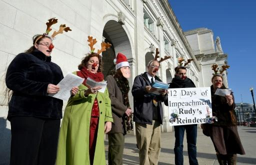"Trump supporters -- like these singing Christmas carols in Washington on December 18, 2019 -- decry the ""partisan"" nature of the impeachment"