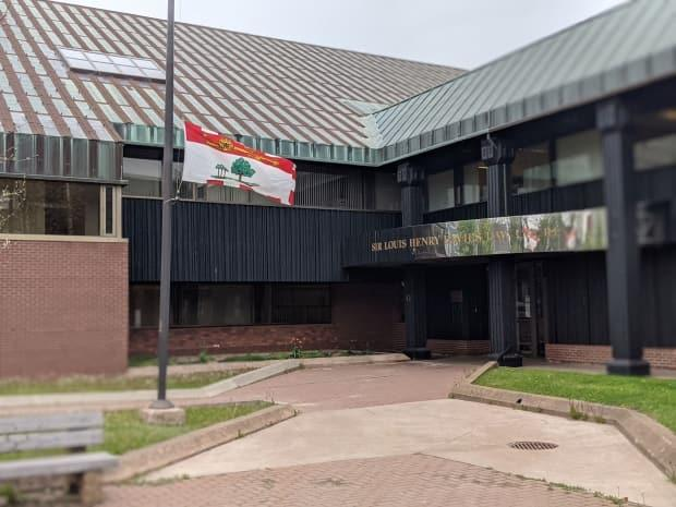 The P.E.I. flag flying at half-mast at the provincial courthouse.