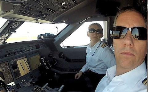 <span>Izabela Lechowicz and boyfriend Eric Swaffer pictured in the cockpit</span>