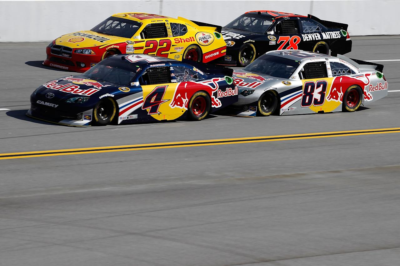 TALLADEGA, AL - OCTOBER 23:  Kurt Busch, driver of the #22 Shell/Pennzoil Dodge, and Regan Smith, driver of the #78 Furniture Row Companies Chevrolet, races side by side with Kasey Kahne, driver of the #4 Red Bull Toyota, and Brian Vickers, driver of the #83 Red Bull Toyota, during the NASCAR Sprint Cup Series Good Sam Club 500 at Talladega Superspeedway on October 23, 2011 in Talladega, Alabama.  (Photo by Jeff Zelevansky/Getty Images for NASCAR)
