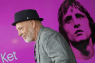 """Director and writer Tom de Ket passes a screen with a picture of Johan Cruyff, during a presentation of """"14 The Musical"""" in Leusden, Netherlands, Friday, June 11, 2021. On the opening day of the pandemic-delayed European 2020 Soccer Championship, the cast and crew of """"14 The Musical"""", referring to Cruyff's shirt number, raised the curtain on the new musical eulogizing the country's most famous footballing son, Johan Cruyff. (AP Photo/Peter Dejong)"""