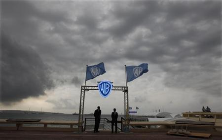 Security guards stand at the entrance of the Warner Bro beach during the annual MIPCOM television programme market in Cannes