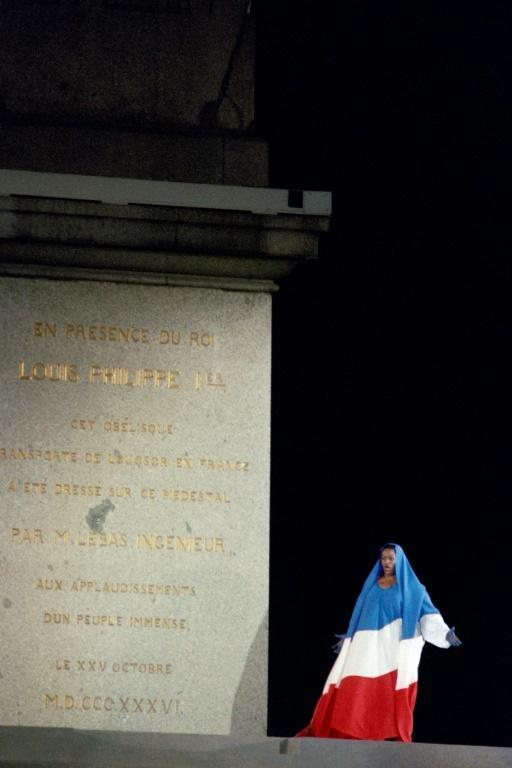 "Jessye Norman, shown here in 1989 draped in the French national flag, sings ""La Marseillaise"" on the Place de la Concorde to commemorate the bicentennial of the French Revolution (AFP Photo/JOEL ROBINE)"