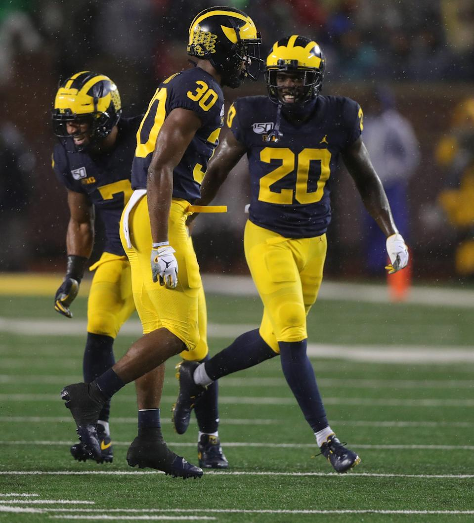 Michigan Wolverines defensive back Daxton Hill (30) celebrates his tackle against Notre Dame with Brad Hawkins (20) during the first quarter Saturday, Oct. 26, 2019 at Michigan Stadium in Ann Arbor.