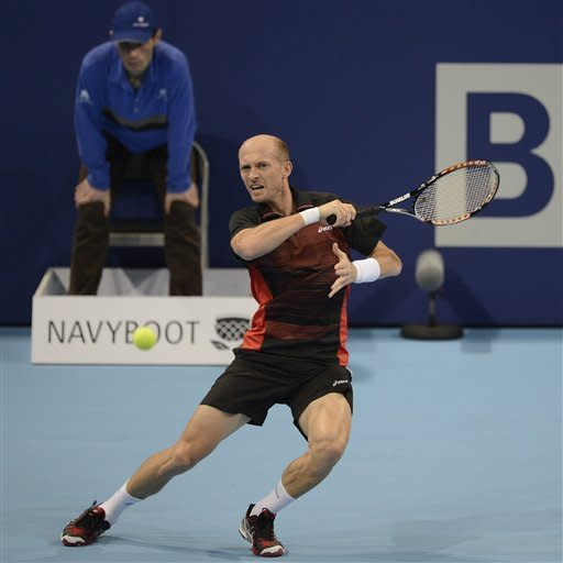 Russia's Nikolay Davydenko returns a ball to France's Paul-Henri Mathieu during their round of sixteen match at the Swiss Indoors tennis tournament at the St. Jakobshalle in Basel, Switzerland, on Thursday, Oct. 25, 2012. (AP Photo/Keystone/Georgios Kefalas)