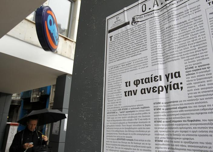 "FILE - In this Thursday, Feb. 14, 2013 file photo, a poster reads ""Why unemployment (is high)?'' outside an office of Labor Force Employment Organization (OAED) in central Athens. Researchers from Greece's largest labor union, the GSEE, say the country's three-year crisis has left nearly two-thirds of private sector employees without receiving their regular salaries. GSEE has called a general strike for Thursday, Feb. 20. (AP Photo/Thanassis Stavrakis, File)"
