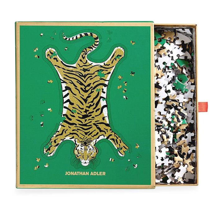 """Both you and Dad can enjoy piecing together this sprawling tiger design by Jonathan Adler. $31, Amazon. <a href=""""https://www.amazon.com/Galison-Jonathan-Safari-Shaped-Puzzle/dp/0735367159/"""" rel=""""nofollow noopener"""" target=""""_blank"""" data-ylk=""""slk:Get it now!"""" class=""""link rapid-noclick-resp"""">Get it now!</a>"""