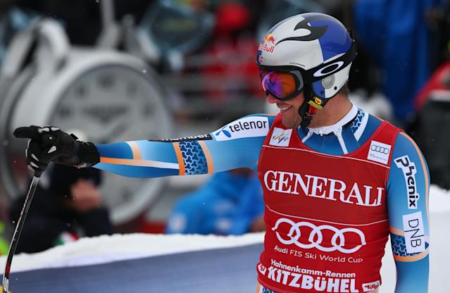 Aksel Lund Svindal of Norway celebrates in the finish area after he placed third at an alpine ski men's World Cup Super G in Kitzbuehel, Austria, Saunday, Jan. 26, 2014. (AP Photo/Giovanni Auletta)