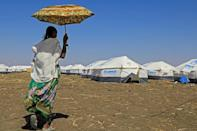 Haven: A woman who fled the Tigray conflict, pictured at the Tenedba refugee camp in Mafaza, eastern Sudan