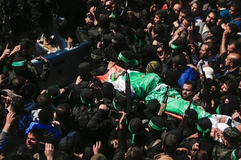 The body of Hamas official Mazen Faqha is carried by members of the Ezzedine al-Qassam Brigades, the military wing of Hamas, during his funeral in Gaza city on March 25, 2017 (AFP Photo/MAHMUD HAMS)