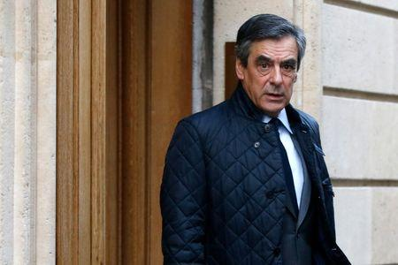 Francois Fillon, former French Prime Minister, member of the Republicans political party and 2017 presidential election candidate of the French centre-right, leaves his home in Paris