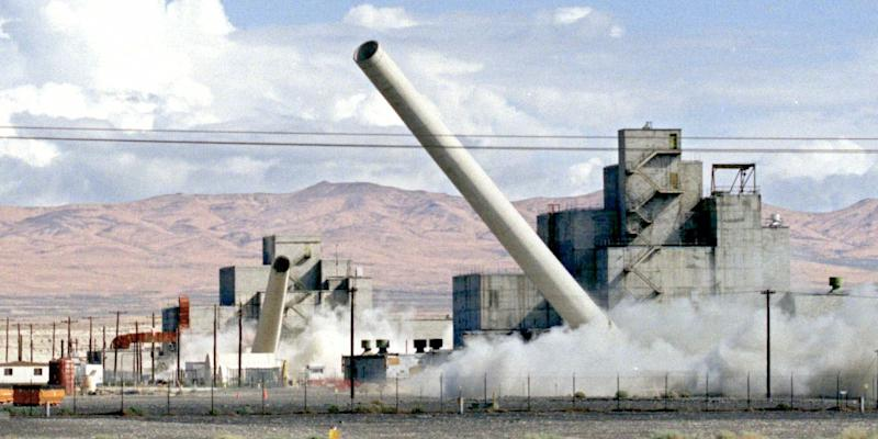 The stacks of two Department of Energy production reactors fall in a simultaneous demolition at the Hanford Nuclear Reservation near Richland, Wash., Saturday, Aug. 14, 1999.