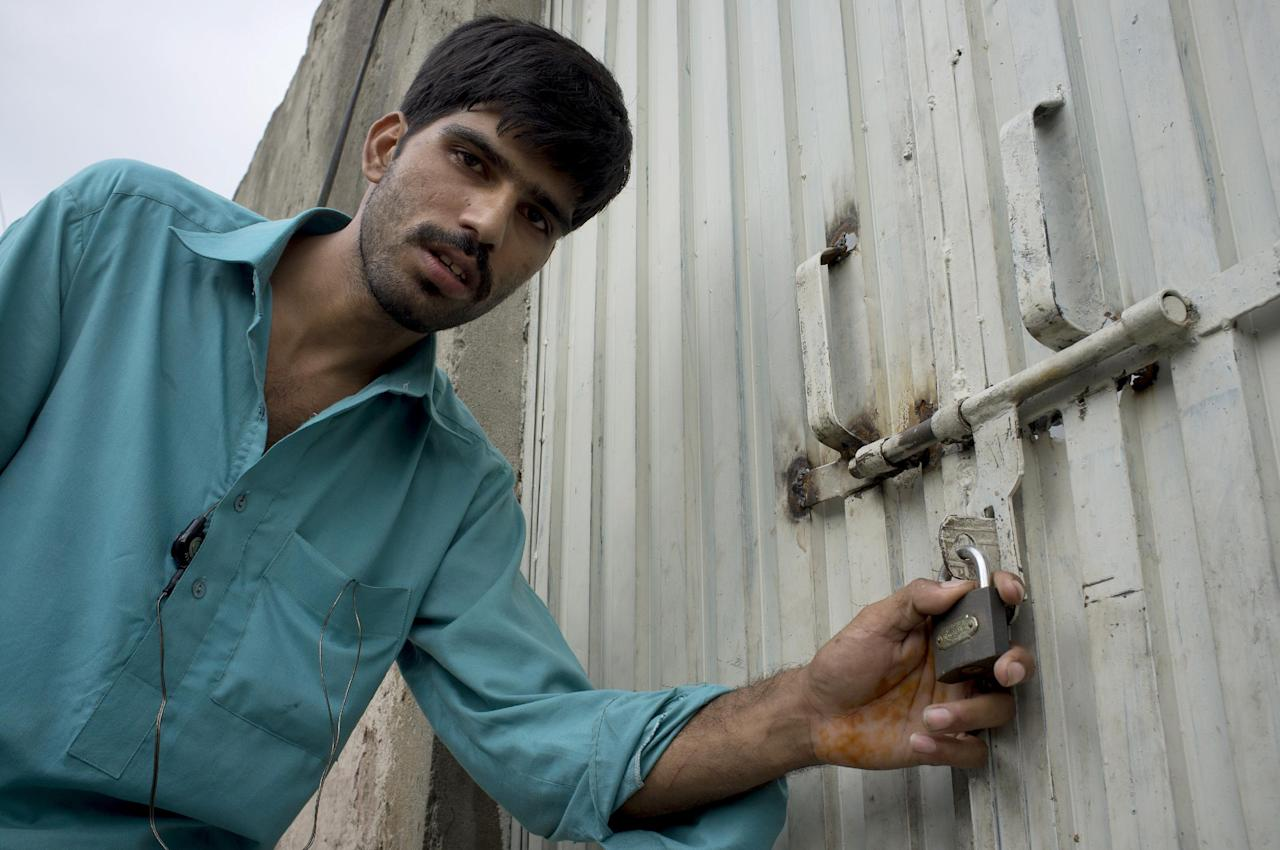 Mukhtar Khan, neighbor of an arrested Christian girl, shows the locked house of a girl and vowed will never allow them to live in this neighborhood, in a suburb of Islamabad, Pakistan on Monday, Aug. 20, 2012. Pakistani authorities arrested a Christian girl and are investigating whether she violated the country's strict blasphemy laws after furious neighbors surrounded her house and demanded police take action, a police officer said Monday. The arrest of the girl and outrage among the local community demonstrates the deep emotion that suspected blasphemy cases can evoke in this conservative Muslim country, where rising extremism often means religious minorities live in fear of persecution. (AP Photo/B.K. Bangash)