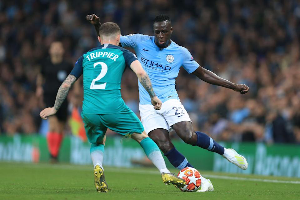 MANCHESTER, ENGLAND - APRIL 17: Benjamin Mendy of Man City battles with Kieran Trippier of Spurs during the UEFA Champions League Quarter Final second leg match between Manchester City and Tottenham Hotspur at the Etihad Stadium on April 17, 2019 in Manchester, England. (Photo by Simon Stacpoole/Offside/Getty Images)