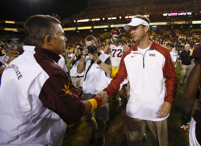 In this Sept. 28, 2013 photo, Arizona State University head coach Todd Graham, left, shakes hands with USC head coach Lane Kiffin after ASU defeated USC 62-41 at Sun Devil Stadium in Tempe, Ariz. USC fired Kiffin early Sunday morning, not long after the team lost 62-41 at Arizona State. (AP Photo/The Arizona Republic, Rob Schumacher)