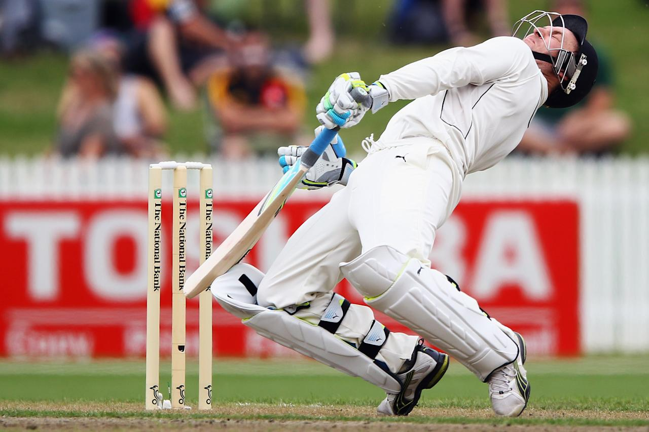 HAMILTON, NEW ZEALAND - MARCH 15: Brendon McCullum of New Zealand falls over after missing a bouncer during day one of the First Test match between New Zealand and South Africa at Seddon Park on March 15, 2012 in Hamilton, New Zealand.  (Photo by Hannah Johnston/Getty Images)