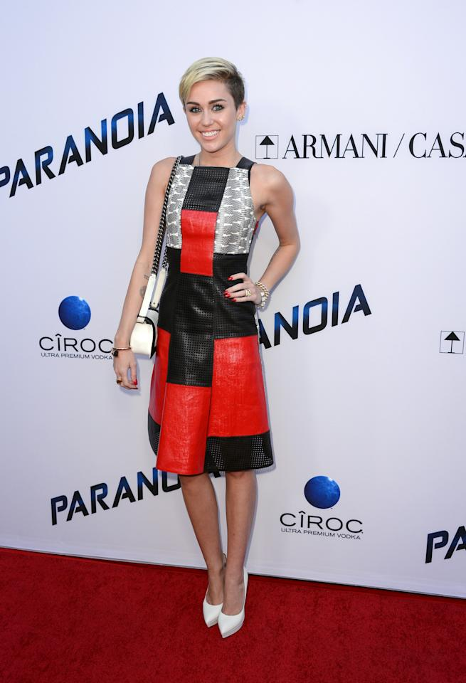 """Miley Cyrus arrives at the U.S. premiere of """"Paranoia"""" at the DGA Theatre on Thursday, Aug. 8, 2013 in Los Angeles. (Photo by Jordan Strauss/Invision/AP)"""