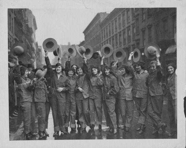 <p>Women helping with the war effort show off their military uniforms while standing across from Broadway. </p>
