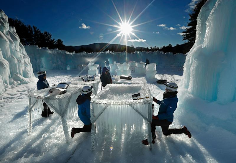 Icicles are harvested for use in growing the walls at Ice Castles in North Woodstock, N.H. The winter wonderland is one of six in North America. (Photo: Robert F. Bukaty/AP)