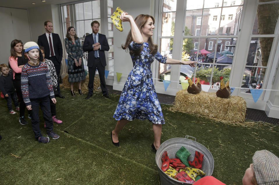 Kate, William and Harry take part in a welly wanging competition in London in October 2015. <em>[Photo: Getty]</em>