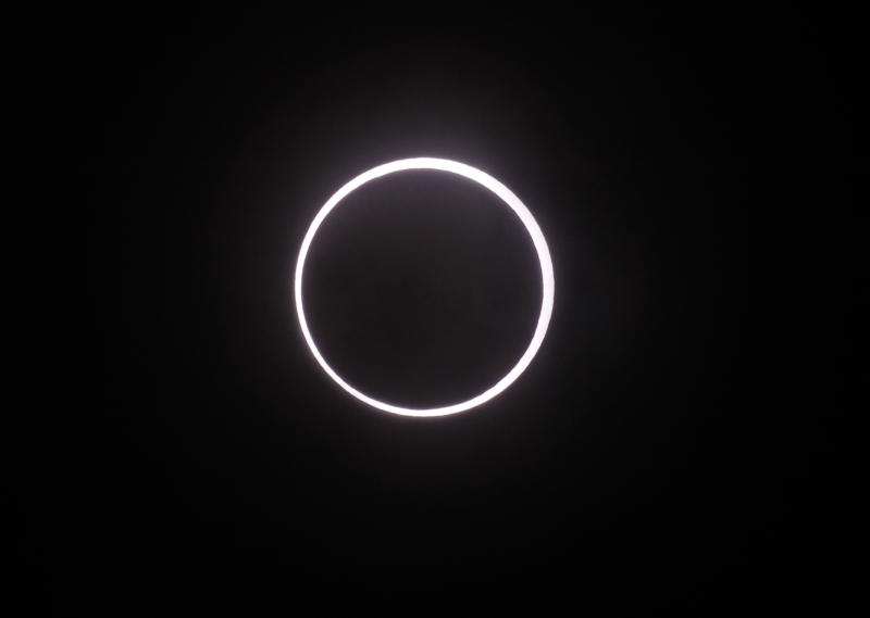 FILE - This May 21, 2012 file photo shows an annular solar eclipse appears in the sky over Yokohama near Tokyo. Solar eclipses typically attract tourists who travel around the world to remote places to witness the celestial phenomenon. Australia is expecting 50,000 visitors for a Nov. 14 solar eclipse that will be visible from the Cairns-Port Douglas area in Queensland. (AP Photo/Koji Sasahara, file)