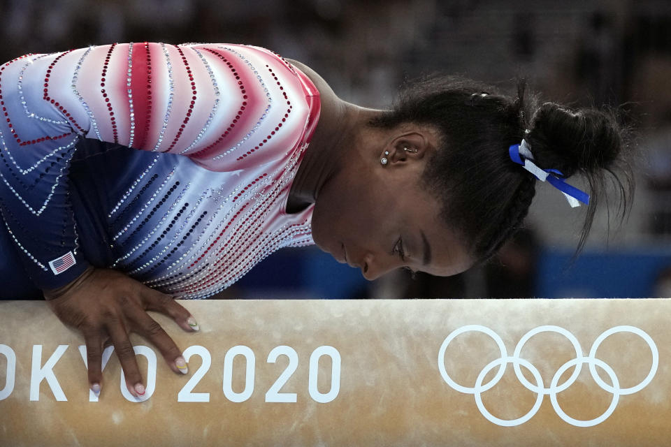 FILE - Simone Biles performs on the balance beam during the artistic gymnastics women's apparatus final at the 2020 Summer Olympics in Tokyo, in this Tuesday, Aug. 3, 2021, file photo. Biles is at peace with her decision to opt out of several competitions at the Tokyo Olympics to focus on her mental health. The seven-time Olympic medalist is happy to spread the importance of putting the person ahead of the athlete, one of the themes of her fall exhibition tour that will feature four other members of the 2021 Olympic gymnastics team (AP Photo/Gregory Bull, File)